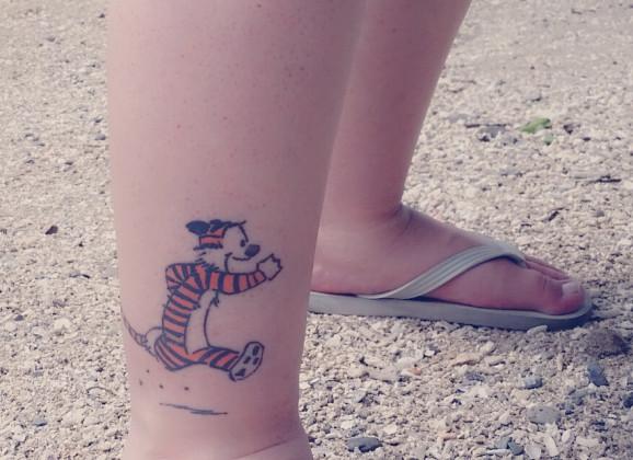 Calvin and Hobbes tattoos at the beach