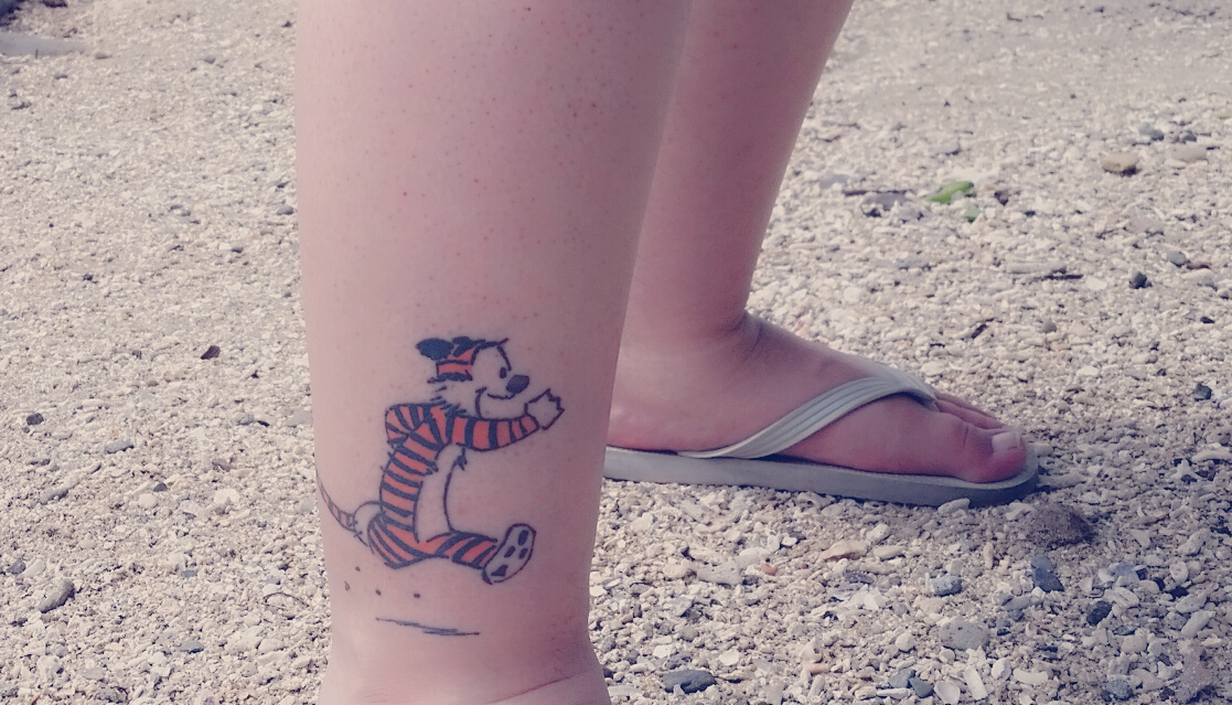 Calvin and Hobbes tattoos at the beach
