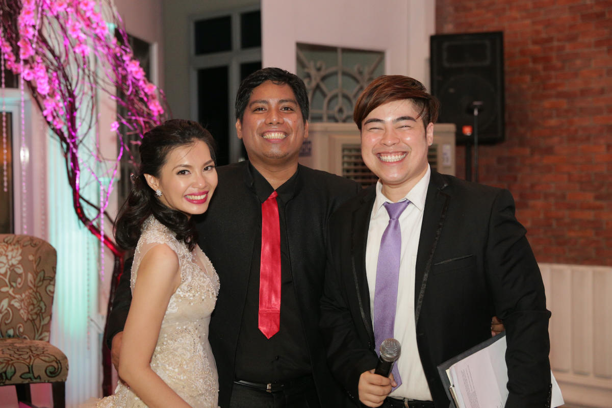 Ganns Deen, a Filipino wedding host in Canberra, with groom Dan and bride Ana